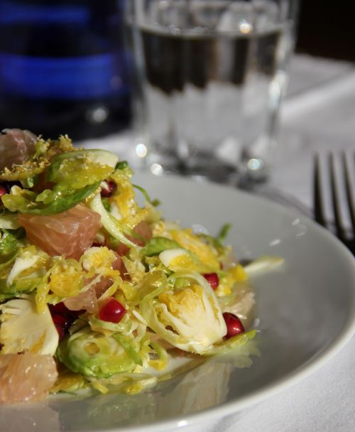 brussels sprouts with pomelo and pomegranate on plate