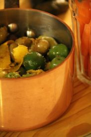 dirty olives in copper pot